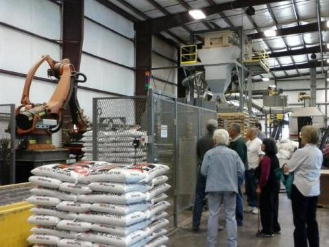 Robot loading bags of pellets at the Pacific Fiber Pellet Plant