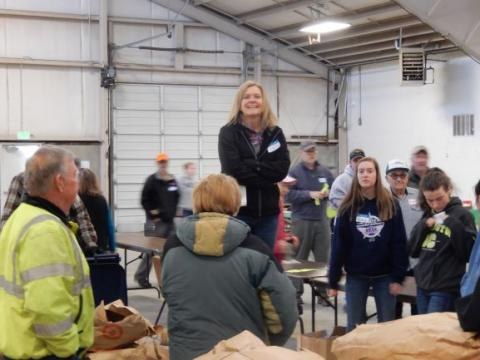 2019 Tree Sale Chairperson Lisa Tiemersma giving directions to volunteers.