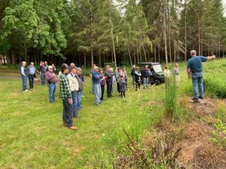 Miller Tree Farm annual summer picnic June 2019.  Ken talking about some difficult replant areas.