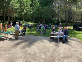 Miller Tree Farm annual summer picnic June 2019.  Ken Bevis talking about critter habitat as only he can do.