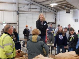 Tree Sale Chairperson Lisa Tiemersma giving directions to volunteers.