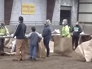 Volunteer members collecting tree orders from public online sales.